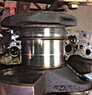The rod bearings and caps attach at the rear of the crankshaft. The rear main seal also is installed here.
