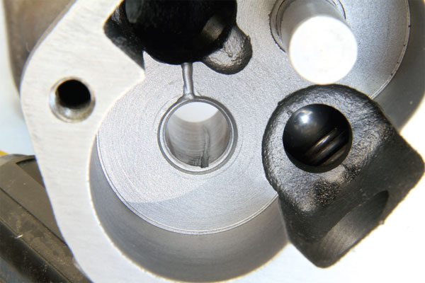 The internal gear surfaces within the Butler Performance Pro-Series oil pump are diamond-lapped for improved consistency. The drive gear shaft is micro-polished and positive lubrication is added to reduce friction and wear. The check ball in the bypass valve and its sealing surface are also blueprinted for maximum pressure consistency.