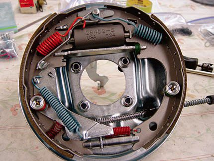 This is a shot of the rear brake assembly for a 1970 Judge convertible. It is complete and ready to be bolted on the end of the axle tube. As with the 1964 front drum system, you can see the color-coded springs and correct finishes. (Photo Courtesy Scott Tie¬mann)