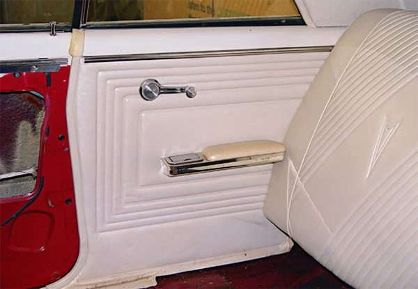 The truth be told, the interior of our 1969 GTO Judge coupe was pretty worn out and needed pretty much everything, which is a common situation. Forty-plus years of sun, heat, and wear take their toll. The seats and door panels were cracked, faded, and musty and the carpeting actually had holes in certain areas. Fortunately, replacements are readily avail¬able. (Photo Courtesy Scott Tiemann)