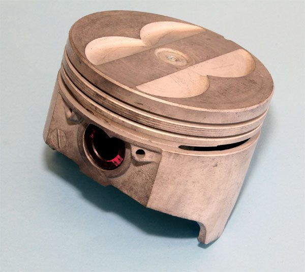 Auto manufacturers used cast-aluminum pistons in production engines for many years. They are cheap to produce, and they operate quietly and consistently throughout an engine's lifetime when properly designed. The piston that Pontiac developed during the late 1960s was an excellent piece. TRW copied its design to produce high performance aftermarket forgings.