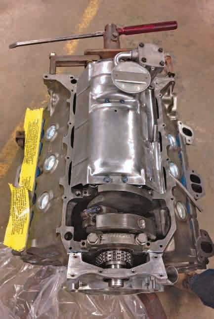 This engine has been professionally rebuilt. It has been flipped over on the engine stand, and the windage tray and oil pump have been installed.