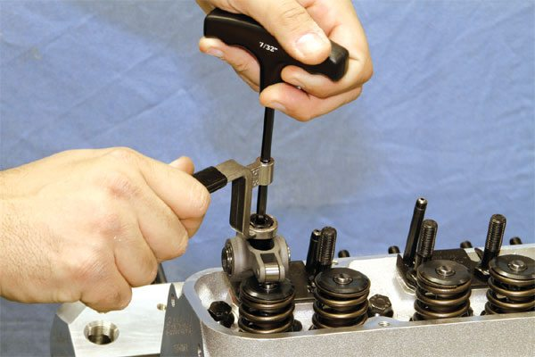 An adjustable valvetrain is required whenever the block and/ or cylinder heads are machined moderately. Proform offers a special wrench (number-66781) that allows for quick and easy valvetrain adjustments when using positive locking rocker nuts. A long-handle 5/8-inch wrench tightens the rocker arm adjuster nut while a 7/32-inch hex-head wrench tightens the internal set screw independently. Once the proper lash adjustment is reached, simply tightening both simultaneously positively locks the rocker nut.