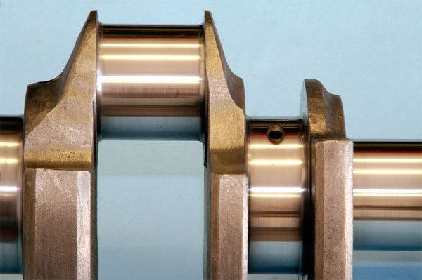 The Pontiac crankshaft design allows a significant amount of main and rod journal overlap, which heavily contributes to its rigidity. It also allows the rod journal to be undersized and its stroke lengthened without grossly affecting its reliability. Adding stroke length increases displacement while improving torque output at low to moderate RPM.