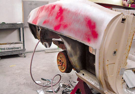 A thorough inspection of this 1970 GTO Judge convertible revealed major rust damage in several areas. In particular, the quarter panels suffered major rust damage, and these parts required replacement in some cases and major repair in other cases. Water spray from passing cars often leads to more rust on the driver's side of the car, and in this case, the driver's side is far worse than the passenger's side.  Although the driver's side was worse than the pas¬senger's side, the passenger-side quarter panel still needs to be replaced. Use an air-powered rotary cut off tool to cut out the rusted outer skin below the beltline. Use the replacement panel to guide the cut off tool across the rusted skin and achieve a straight cut. Drill out the factory quarter-panel spot welds, so the panel can be removed. Use a special spot weld drill bit, which drills a 1/8-inch hole in the center and then cuts away the top metal in the spot weld until it is freed from the bottom half of the weld. Note that this rocker panel is still in very good condition and the outer wheel well only has minor rust-through along the edges. (Photo Courtesy Scott Tiemann)