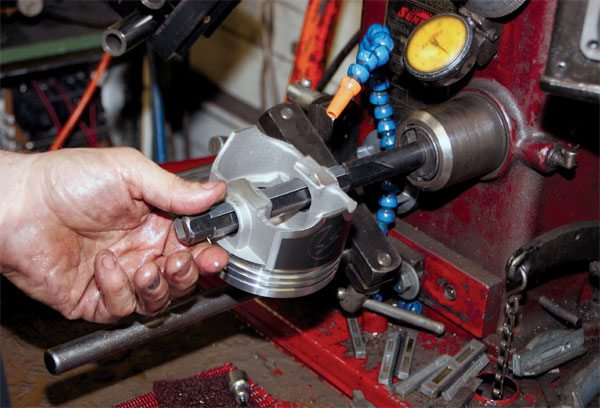 Before placing a new piston set in service, plan to have your machinist verify the diameter of the wrist pin bore of the entire set. The intent is to ensure that it's within the suggested tolerance with the wrist pins being used. Don't be alarmed if some minor honing is required, especially if floating pins are used.