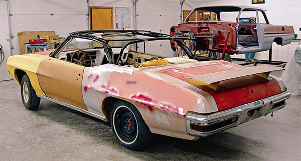 Looks can be deceiving. This 1970 Judge convertible seemed to have a solid body not requiring extensive body work. However, it was hiding some sig¬nificant problems. In addition to both rear quarters needing to be replaced, it needed new floorpan panels, as well as new portions of the trunk floor. The interior was removed to reveal that the floorpans were rusted in certain areas and needed to be replaced. Inspecting the trunk also revealed a certain amount of rot that necessitated patches. While both quarter panels seemed to be solid from the outside, a lot of rust was lurking around the wheel wells and these needed to be replaced. (Photo Courtesy Scott Tiemann)