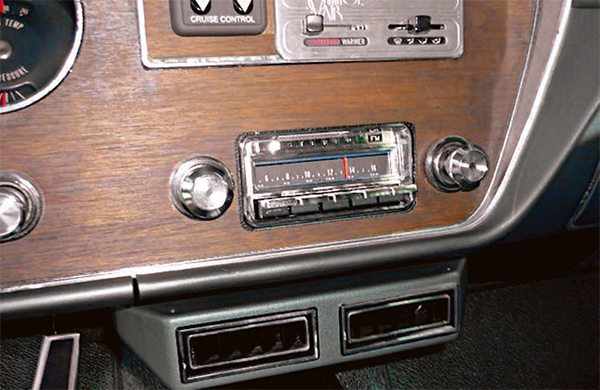 The stereo in Les Iden's 1966 GTO is an interesting blend of old and new. The car features a reproduction of the 1966 Pontiac A-Body AM/FM radio from Antique Auto Radio. It looks authentic on the outside but uses all modern internals. With a shallower chassis, it allows for easier installation and features mini-plug inputs so you can hardwire an iPod or satellite radio receiver directly into it. It also features 45 watts of power in each of its four channels and is an excellent alternative for those wishing for modern sound with an authentic look.