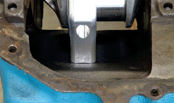 Because aluminum is not as strong as steel, aluminum connecting rods must be bulkier to provide a durability level similar to forged units. Depending upon the amount of crankshaft stroke, some areas of the block (particularly the bottom of the cylinder bore) may need to be relieved with a grinder to gain sufficient rotational clearance.