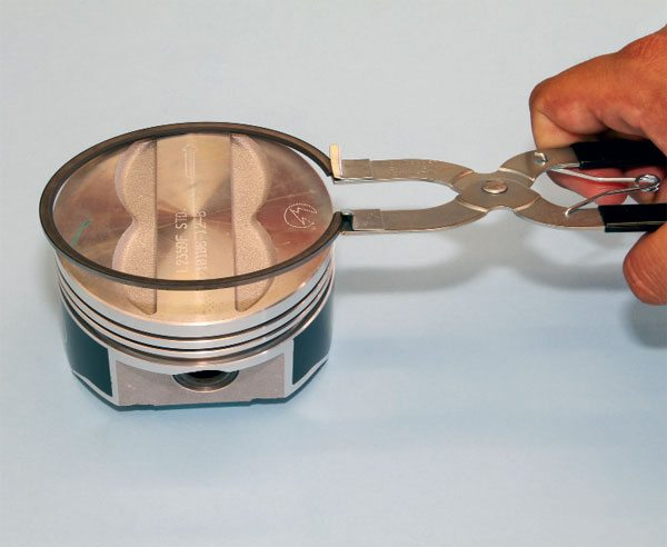 Hobbyists have found several ways to install piston rings. Some cause permanent distortion or a loss of tension, however, which greatly affects its sealing ability. After end gap has been measured and/or adjusted accordingly, a compression ring is properly installed onto a piston by spreading it with a special tool until it just fits over the head and then is carefully slipped into place. Remember a top ring is often gapped differently than a second, and some ring kits require special orientation, so plan accordingly.