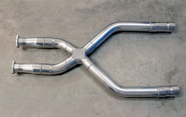 An X-type crossover creates a split junction that merges the head pipes, allowing the exhaust pulses from one to draw off the other, improving exhaust scavenging, and engine performance. It also gives the exhaust charge two paths in which to exit, effectively increasing the capacity of the entire exhaust system.