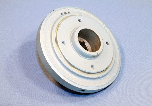The stock Pontiac harmonic damper introduced in 1968 is a pressed-together design that's most common. It worked quite well in original applications, but it's not uncommon to find the rubber isolator that separates the hub from the outer ring has lost its dampening ability from more than 30 years of use. NOS units are still available and are suitable for stock rebuilds, but I recommend an aftermarket unit for high-performance use.