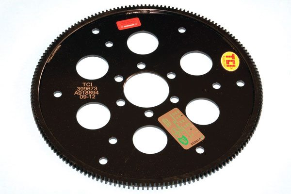 A flexplate connects the torque converter of an automatic transmission to the flywheel. Constructed of a sheet metal, the holes cut into it allow it to flex slightly, taking up torque converter movement at higher engine speeds. Originals were adequately made for stock applications, but the aftermarket unit from the TCI unit is much beefier. It's an excellent choice that's SFI certified and fits quite well.