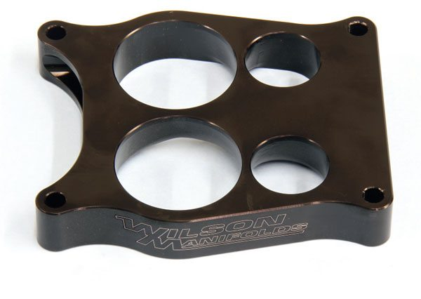 For those running a Quadrajet, Wilson offers an excellent spread-bore spacer that's fully divided and contains its unique tapered-bore design. It's a beautifully machined unit that noticeably improves engine output at all speeds. At 1 inch thick, it creates hood clearance issues with some Pontiac models, but it's certainly one to consider if you have extra room.