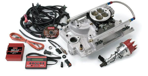 Complete fuel-injection systems, such as the Edelbrock Pro-Flo, contain all the necessary components to convert your carbureted Pontiac to electronic fuel injection. The Edelbrock system includes the computer, all associated wiring, a large square-bore throttle body, and a modified intake manifold with runners designed to accept high-flow fuel injectors and a high-pressure fuel rail. A hand-held tuner is used to adjust the fuel mixture and spark timing to provide peak performance in all conditions. (Photo Courtesy Edelbrock, LLC)