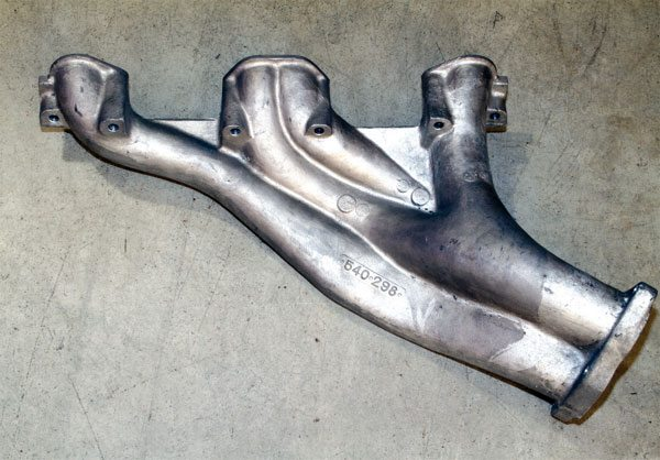 """Pontiac developed a """"tuned"""" header constructed of cast-iron for its early Super Duty engines and it was an excellent piece. It performed as well as any tubular header of the era. Its only drawback was weight. A cast-aluminum version was produced for weight-conscious racers. RARE manufacturers cast-iron and aluminum reproductions."""