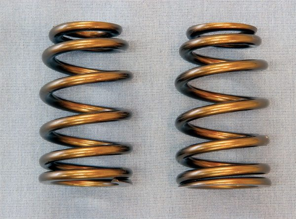Conical (or beehive) valvesprings are growing increasingly popular. Tapering as it spirals toward the top, its shape better dissipates resonate harmonics to improve valvetrain stability while allowing a smaller retainer to reduce valvetrain mass. Its ovate wire provides sufficient spring pressure without the need for a second internal spring. While not required for every application, the use of conical valve springs in modern Pontiac builds is widespread.
