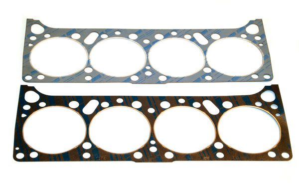 Fel-Pro offers two different Pontiac cylinder head gaskets that share the same basic shape and size. The design is a compilation of the many stock replacement units Fel-Pro offered over the years, and it's compatible with most popular Pontiac blocks. PN 8518 (top) is a stock replacement unit while PN 1016 (bottom) is a high-performance gasket with a solid-steel core and premium fire rings. Completely coated in Teflon, Fel-Pro recommends installing its head gaskets dry.