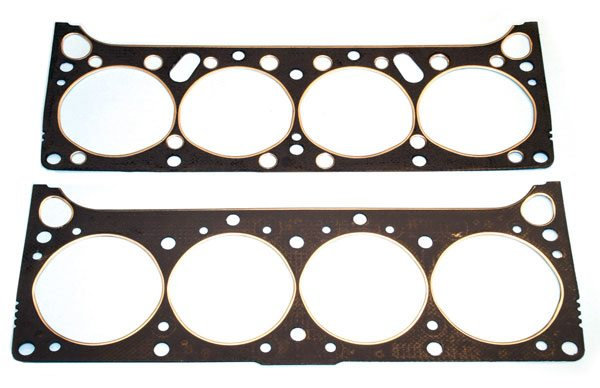 Composition cylinder head gaskets from Butler Performance were developed using the original Pontiac blueprints. This design consists of a steel shim with a graphite coating on one side, and can provide excellent seal when combined with copper sealer. Butler Performance was able to size and locate bore-diameter and coolant passages for specific applications just like the originals. It's easy to see how Butler 's 421-spec unit (top) differs from the 400/455 unit (bottom).