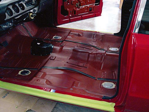 The wiring passes from the front of the car to the rear. Most notably, the wiring for the taillights and reverse lamps, as well as side-marker lamps, are routed and protected by plastic or rubber tubes. These tubes keep the wir¬ing dry and safe from the constant rubbing caused by passenger footwear on the carpeting. Most often these tubes are in good shape and can be reused, as long as the carpeting is intact on your car and the floorboards aren't rusted out. Use a multi-tester to make sure that all the wiring is still func¬tional and replace the wiring that does not complete a circuit. Simply connect the multi-tester's probes to the connections to see if current passes though the wiring. If it does, the gauge on the face of the multi-tester moves to show the current flow. If if doesn't, it stays at zero. (Photo Courtesy Scott Tiemann)