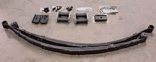 A typical rear-suspension restoration kit includes U-bolts, shackles, axle pads, and leaf springs.
