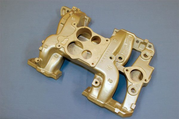 A cast-aluminum intake manifold was developed to complement Pontiac's highest performance production engines of the late 1960s and early 1970s. Its runners were enlarged to accommodate the increased airflow capacity of the Ram Air IV and 455 H.O. engines it was used with. The aluminum construction improved heat dissipation. A separate cast-iron exhaust crossover (not shown) housed a divorced choke stove.