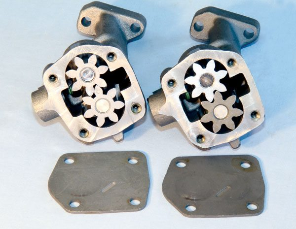 Melling produces two stock replacement Pontiac oil pumps. Each is available in 50- or 70-psi variants, which generally produces 60 and 80 psi, respectively, with normal production bearing tolerances. The standard pump (left) is built to exact OE specifications. The Select Performance pump (right) features tightened tolerances and billet gears to improve performance and reliability, particularly at high engine speed.