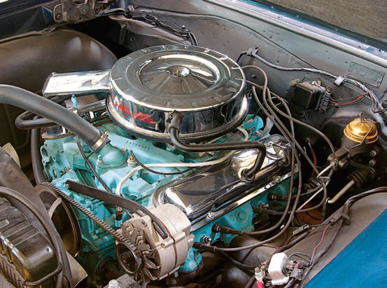 Another older restoration, this 1964 has several minor mistakes or non-original equipment items under the hood. These include the belts, hoses, fasteners, and fin¬ishes. The block and manifold are also painted. The master cylinder inspection cover was spray painted gold, which is incorrect but generally presentable and fine for a driver-quality machine.