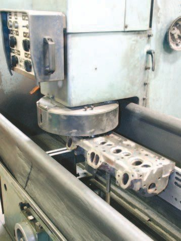 A surface mill is required when removing material from the mating surfaces of a block or cylinder head. Other uses include resurfacing a manual-transmission flywheel, or intake or exhaust manifold flanges. It's a valuable piece of equipment that any machine shop should have.
