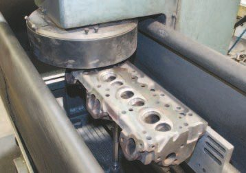 The cylinder head is installed in a surfacing mill and a minimal amount of material is removed from the deck surface to ensure it's completely flat for maximum cylinder seal. The process also reduces combustion chamber volume, and that's something to be considered when rebuilding a high-compression engine that operates on pump fuel. When dealing with Pontiacs, it's generally accepted that each .005 inch removed from the cylinder head deck surface reduces combustion chamber volume by 1 cc. It's highly recommended to physically measure chamber volume before and after any machining.