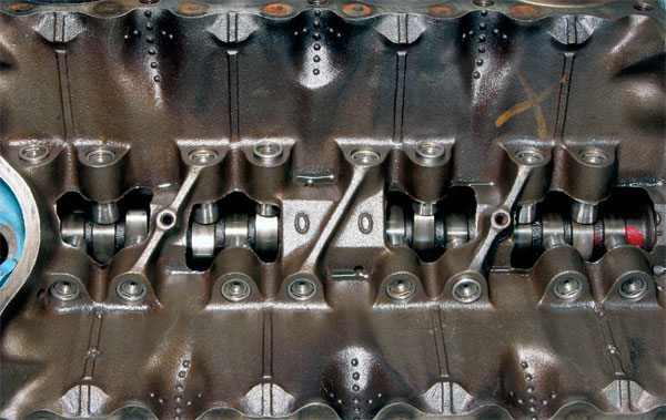 "The camshaft opens and closes the valves at specific points in crankshaft rotation. Nearly all production engines were fitted with hydraulic valve lifters. Notice the ""00"" cast into the lifter galley. It denotes 400-ci displacement."