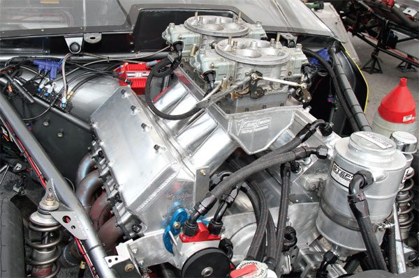 The induction system of a Pontiac V-8 typically consists of a carburetor and intake manifold. Each is designed to maximize performance in a particular range. Larger race engines that operate at high speed require a significant volume of fuel and air, and that requires a unique intake manifold with multiple carburetors.