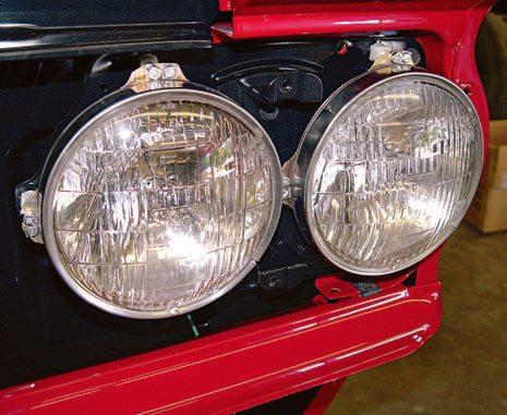 Although concours judges like to see a set of original T-3 headlamps with the molded-in triangle, the truth is, they were not that great, performance-wise. A modern set of replacement sealed-beam headlamps is a wise addition to a driver-type restoration. As an example, Hella H-4 lamps are a huge improvement over the originals and are available just about any¬where, including Amazon.com. Just be sure to save the original T-3s, if they are still with the car, as they are quite valuable. (Photo Courtesy Scott Tiemann)