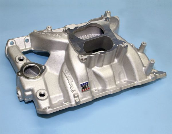 The Performer RPM from Edelbrock is a high-performance dual-plane that provides excellent throttle response and low-speed street manners while allowing for excellent engine horsepower. It's much taller than a stock manifold and that can be an issue in certain applications, but it's the best aftermarket dual-plane ever produced for the Pontiac V-8.