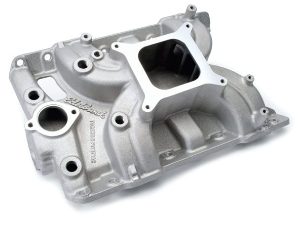 Edelbrock's Torker II is a single-plane manifold that features a relatively small plenum with long, narrow runners that provide strong mixture velocity. The result is the ability to mimic dual-plane performance at lower speeds while maintaining excellent high-speed performance. The plenum volume is a bit small for larger engines. A carburetor spacer measuring at least 1 inch generally yields a performance improvement. (Photo Courtesy Edelbrock, LLC)