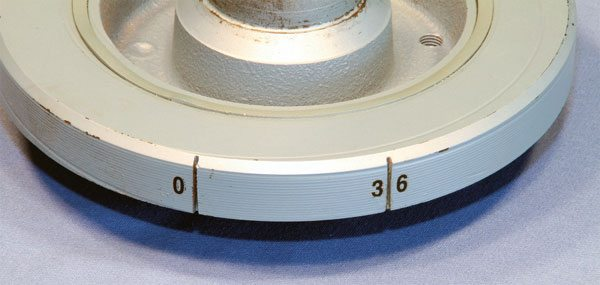 The outer ring of the stock Pontiac damper is marked for top dead center (TDC) only. This makes total timing adjustment an impossible process unless you own a dial-back timing light. A popular modification is to add one or more marks that represent other timing points. Indexing is easily accomplished by measuring the circumference, dividing it by 360 degrees, and multiplying by the desired timing number. Simply scribe another mark that distance from the TDC mark in a clockwise manner. I routinely label mine for easy visual identification.
