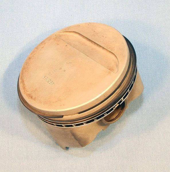 Pontiac specified forged-aluminum pistons for its Super Duty and Ram Air IV engines. The SD-455 piston was a unique design specific to that application. It contains many features aimed at maximizing durability; among them is a single-trough valve pocket, which displaces just over 3 cc. Federal-Mogul offered this piston (number L2423F) in various over sizes in its Speed Pro line, but was discontinued in February 2007.