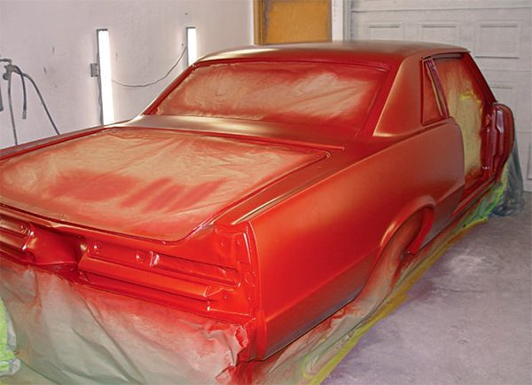 The advantages of a professional spray booth cannot be overstressed because if it is correctly prepared and operated it provides the optimal environment for painting. A booth offers temperature and humidity control, keeps contaminants away from the surface to be painted, and controls overspray. While you can build a temporary paint booth to paint your car at home, the process takes a lot of time, preparation, and work. Even a temporary paint booth doesn't control contaminants as well as a professional one. If dust is present, it will show up in the paint and produce flaws that must be fixed. The dust factor alone should be enough to send your car to a professional body shop. Body work and painting are often the most expensive portion of a restora¬tion project. To paint a GTO or any classic car the right way is expensive, but the top-quality results are worth the investment. So you should strongly con¬sider having a shop paint your car. Along with the superior painting area, a successful body shop employs highly-skilled technicians able to give your car the best possible outcome. You may pay more up front, but the savings in time and quality is significant. Plus, if you end up with less-than-acceptable results, how much of a savings is that? (Photo Courtesy Scott Tiemann)