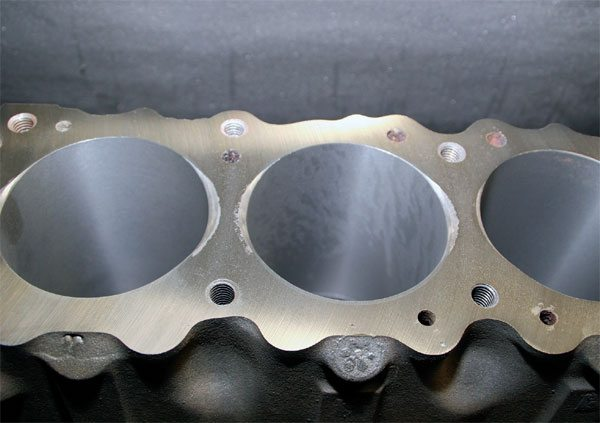 When cylinder heads and blocks are surfaced, the equipment leaves behind a finishing pattern. The roughness of the finish must be compatible with the cylinder head gasket or it can be torn apart as the block and heads expand and contract during normal operation. Most gasket manufacturers publish a roughness average (RA) range for their gaskets. It's very important to follow the RA recommendations for maximum gasket reliability.