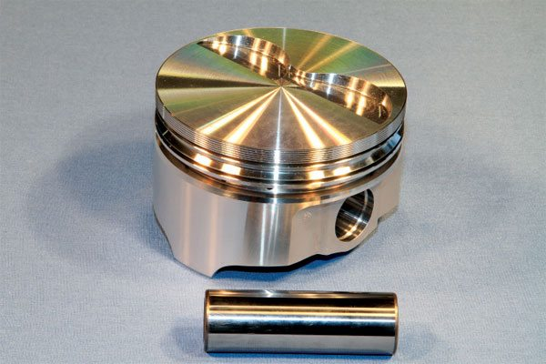 Keith Black (KB) offers a number of off the- shelf forged pistons for Pontiac V-8s in its ICON line. Readily available from mail-order companies or Pontiac parts suppliers for about $400 and constructed of low-silicon 2618-alloy with thin ring packages, KB pistons are an excellent choice for any serious performance application. They are available with press-fit or floating wrist pins for stock-length or longer connecting rods, and with a variety of valve pocket volumes.