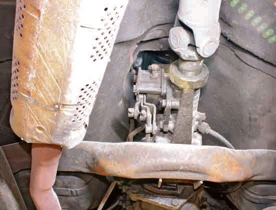 Remove the bolts that connect the transmission to the crossmember.
