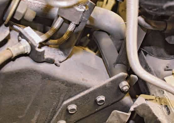 Use a socket and ratchet to disconnect the Z-bar clutch mechanism.