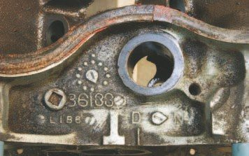 "The block's casting date is generally located on the distributor pad, and ""L186"" found on this unit translates to December 18, 1966 (L = Dec, 18 = 18th day, 6 = last digit of 1966). The block casting number is also found in this area on most 1964–1967 castings. The visible digits in this example are what remain of the original ""9786133"" after machining. It indicates that this block is a 1967 400."