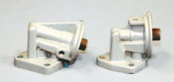 The Pontiac V-8 uses a bolt-on oil filter adapter, and the type most hobbyists are familiar with comes in two distinct versions. One places the filter at about a 70-degree angle from the block (left) while the other places the filter at a 90- degree angle. The original application depends upon the type used to assemble a particular Pontiac. The 75-degree unit seems most common and tends to provide the best exhaust system and chassis clearance.