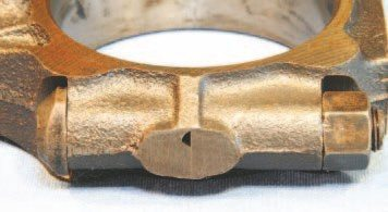 The cast connecting rod includes a machined groove that serves to direct a jet of lubrication toward the camshaft and cylinder wall. Most likely because of emissions concerns, it was eliminated in September 1972. Factory literature states that the two rod types can be freely interchanged. Your rebuild can include either, but modern bearings do not include the required feedhole, which renders the feature useless.