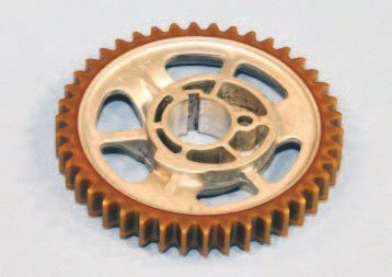 Many Pontiacs were originally assembled with a timing set that used a cam gear with nylon teeth. Intended to provide quiet operation and less operational load, it was prone to failure because the unit aged and the nylon teeth grew brittle. Any that broke off almost always ended up in the oil pan sump, where it posed no threat. A steel cam gear is always recommended for any rebuild.