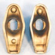 Pontiac used 1.5:1 stamped steel rocker arms in nearly all its V-8 applications. A 1.65:1 rocker arm was developed to increase gross valve lift of early Super Duty and R/A-IV engines by 10 percent over its 1.5:1 counterpart. Moving the pushrod cup toward the rocker stud increases the ratio. The difference is virtually undetectable unless the original units are compared side by side. A 1.5:1 stamped steel rocker arm is on the left while a 1.65:1 unit is on the right. Both are original Pontiac units.