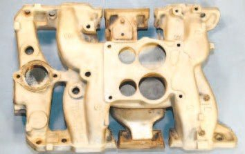 High-flow R/A-IV and 455 H.O. cylinder heads feature intake ports that are taller than those of a conventional D-port casting. A specific intake manifold was developed for those applications. With an appearance identical to the standard manifold, its runners were enlarged internally to support additional airflow. Instead of using cast iron, however, the high-flow units were aluminum and contained a separate cast-iron heat crossover.