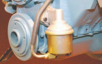 The mechanical fuel pump was mounted on the front of the engine, where it received airflow wash from the cooling fan. Canister units like this begun appearing on production vehicles during the 1960s. AC Delco was the original supplier in most instances, and direct replacements are still available for many popular applications.