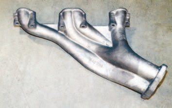 Pontiac's cast header was developed to maximize exhaust efficiency of the early Super Duty engines. It featured a bolt-on collector that could be uncapped to bypass the exhaust system. The most common unit was constructed of cast-iron, but a cast-aluminum version, like this reproduction from Ram Air Restoration Enterprises (RARE), was available for certain applications. The Super Duty castings offer tube-header-like performance.